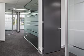 Glass office walls with frosted privacy stripes
